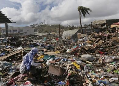 A survivor eats a banana found in a garbage heap.