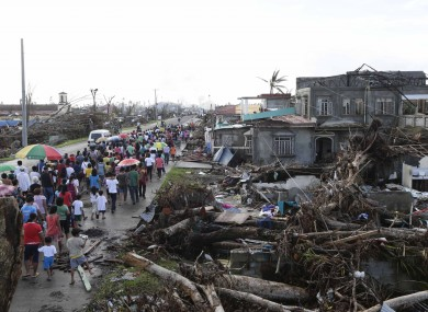 Typhoon survivors take part procession for the victims in Palo township, Leyte province