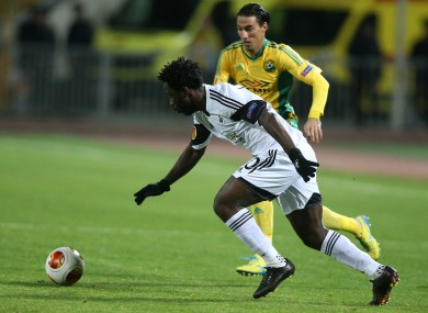 Swansea City's Wilfried Bony controls the ball as Kuban Krasnodar's Ivelin Popov closes him down.