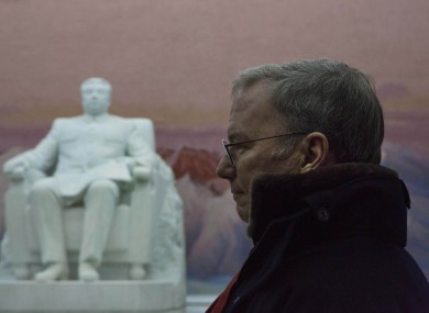 Google Executive Chairman Eric Schmidt stands near a statue of the late North Korean leader Kim Il Sung during his time in North Korea.