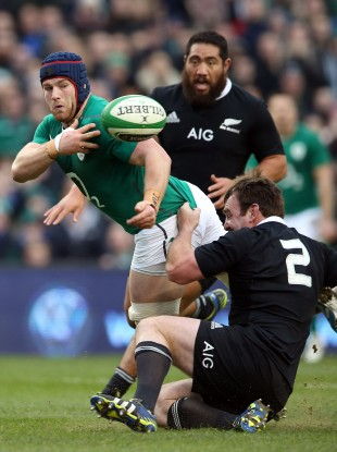 Sean O'Brien attempts an offload against New Zealand.