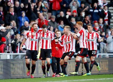 Bardsley is contragulated by his team-mates.