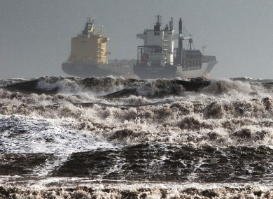 Two tankers are battered by gale winds in the rough waters of the Gulf of Cagliari, Sardinia, yesterday.