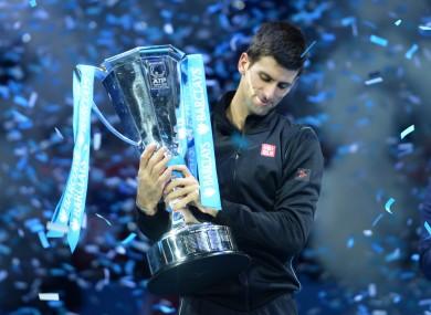 Djokovic lifts the trophy.