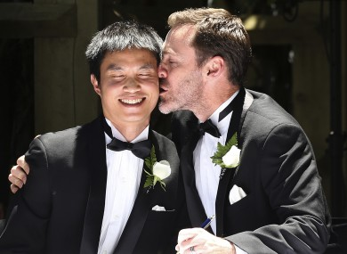 Ivan Hinton, right, gives his partner Chris Teoh a kiss after taking their wedding vows during a ceremony at Old Parliament House in Canberra just last week.