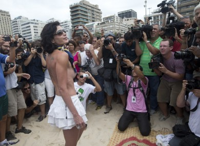 A woman poses for photos during a protest against a topless ban on the Ipanema beach in Rio yesterday.