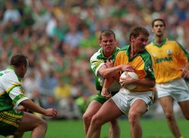 Dara Ó Cinnéide of Kerry tackles Darren Fay of Meath.