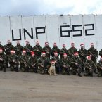 The 4 Platoon, B Company, 42 Infantry Group UNIFIL put their Santa hats on at the canine command of mascot Sgt Blueline Bob at UN post 6-52 in Lebanon.<span class=