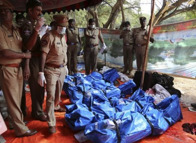 Police officers stand by the bodies of passengers killed in a train accident at Kothacheruvu, about 155 kilometers north of Bangalore, India.