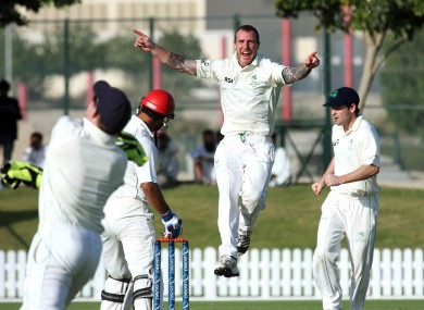 Ireland's John Mooney leaps with delight after dismissing Nawroz Mangal of Afghanistan.