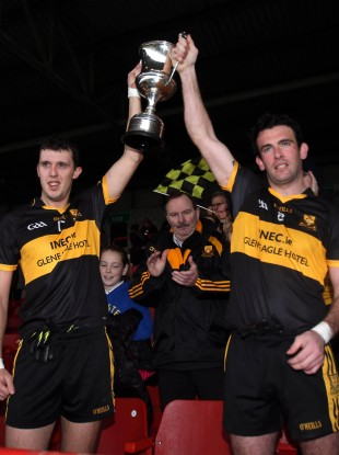 Michael Moloney and Ambrose Donovan lift the cup for Crokes