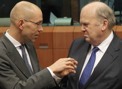 Finance Minister Michael Noonan speaking with Jorg Asmussen, Member of the Executive Board of the European Central Bank (left), during the Eurogroup meeting earlier this week.