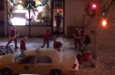 WATCH: Drunken Santas brawl on