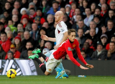 Manchester United's Adnan Januzaj (right) before being booked for diving after taking a tumble ahead of West Ham United's James Collins.