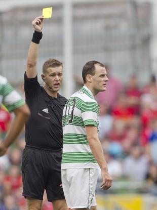 Referee Alan Kelly books Celtic striker Anthony Stokes.
