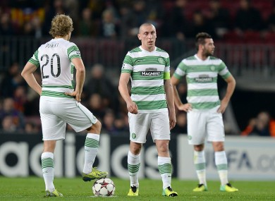 Celtic's Scott Brown (centre) and Teemu Pukki (left) wait to restart the match after Barcelona's Neymar (not in picture) scored his team's third goal.
