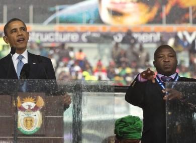 Thamsanqa Jantjie, right, interprets in sign language for President Barack Obama