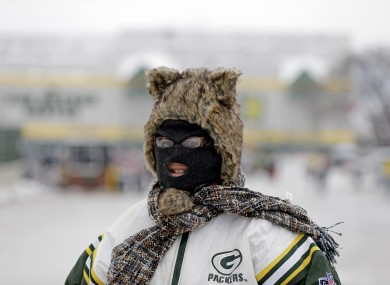 A Green Bay Packers fan is seen bundled up before the NFL wild-card playoff football game between the Green Bay Packers and the San Francisco 49ers