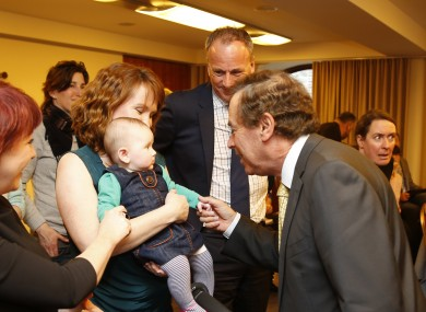 Alan Shatter is pictured with 5-month-old Edie Rose Robinson Griffith and her mother Moninne Griffith.