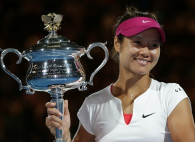 Li Na poses with the Australian Open trophy after her straight sets win.