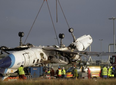 File photo from 2011 of the plane being removed from the crash site.
