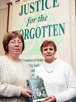 File: Marian Walsh who son was murdered by loyalists with Margaret Urwin Group Secretary at the Justice for the Forgotten offices