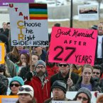 Supporters of gay marriage gather for a rally at the Utah State Capitol, in Salt Lake City. Opponents and supporters of gay marriage held twin rallies at the Capitol on Tuesday. More than 1,000 gay couples rushed to get married when a federal judge overturned Utah's constitutional amendment banning same-sex marriage in late December 2013. In early January the US Supreme Court granted Utah's request for an emergency halt to the weddings. <span class=