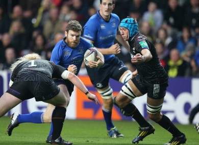Justin Tipuric (right) and Duncan Jones tackle Leinster's Gordon D'Arcy.