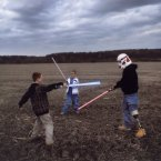 Raymond Hubbard, an Iraq War veteran with a prosthetic leg, puts on a Star Wars storm trooper's helmet and engages his sons in a light-saber battle in 2007. His father was similarly injured in Vietnam.<span class=