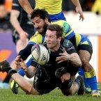 Connacht's Jack Carty gets his pass away under pressure.<span class=