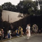 A woman and child visit the Vietnam Veterans Memorial in Washington, D.C., 1986. The wall, which features the names of all those killed or missing in action, was completed in 1982.<span class=