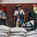 Muchachos await a counter-attack by the National Guard during the Nicaraguan Revolution in 1978.<span class=