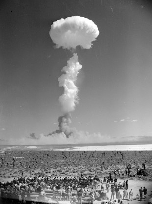 In this April 22, 1952 file photo, the mushroom cloud of an atomic bomb rises above Nevada's Yucca Flat.