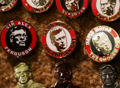 Alex Ferguson and David Moyes badges on sale outside Old Trafford last night.