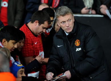 Manchester United manager David Moyes signs autographs for fans before the Capital One Cup defeat to Sunderland.