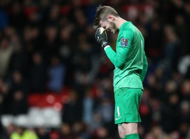 Manchester United's keeper David de Gea stands dejected after his mistake for the second goal.