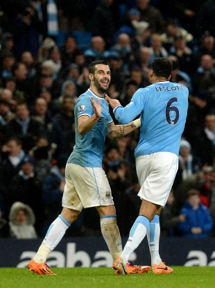 Alvaro Negredo (left) celebrates scoring his side's first goal.