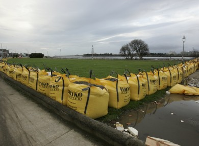 Large sandbags being used to reduce the flooding along the Clontarf Road