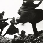 Russian soldiers charge forward on the Eastern Front in 1941.<span class=