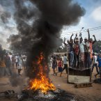 17 November 2013, Central African Republic: Demonstrators gather on a street in Bangui to call for the resignation of interim President Michel Djotodia following the murder of Judge Modeste Martineau Bria by members of Seleka. <span class=