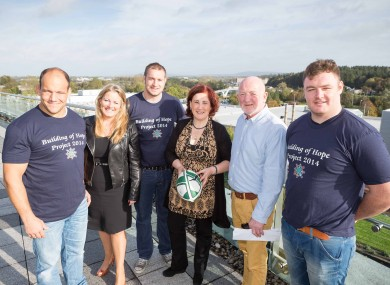 Munster players BJ Botha, Johne Murphy and Dave Kilcoyne with Building of Hope directors Maureen McCarthy, Jim Lynch and Mary Howard.