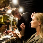 A model for the Amores Trash Couture collection gets her make-up done backstage at Buenos Aires fashion week. <span class=