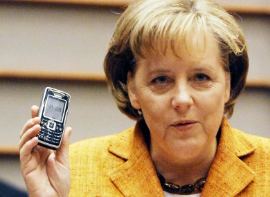 German Chancellor Angela Merkel and her mobile phone.
