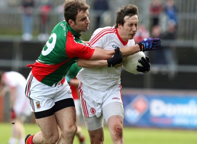 Colm Cavanagh of Tyrone and Jason Gibbons of Mayo