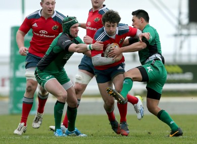 Connacht's Dave McSharry and Miah Nikora tackle Harry McNulty of Munster.