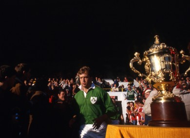 Hugo MacNeill runs by the Webb Ellis Cup in 1987.