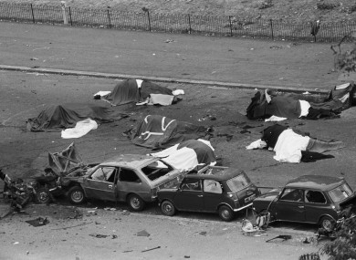 File photo dated 20/07/82 of dead horses covered up and wrecked cars at the scene after an IRA bomb exploded as the Household Cavalry was passing, in Hyde Park, London.