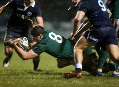 Ireland's Jack O'Donoghue scores the opening try against Scotland.