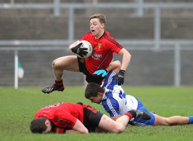Down's Jerome Johnston in action with Monaghan's Drew Wylie.