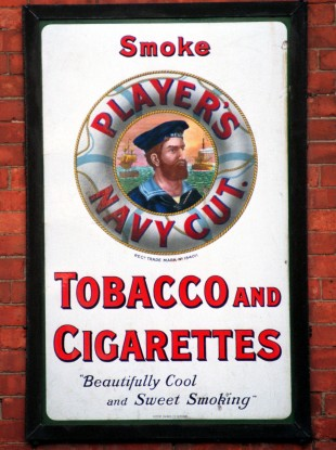 A sign for Players Navy Tobacco and Cigarettes outside an antique shop in Limerick City in 1998.